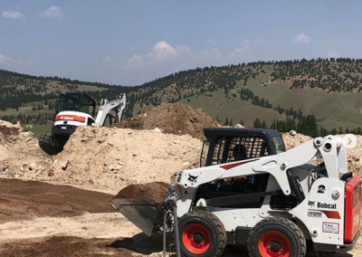 septic-system-digging-skid-steer